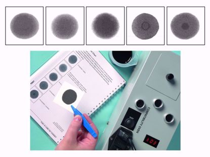 Pack of chromatography papers used in testing for insolubles and compatibility.
